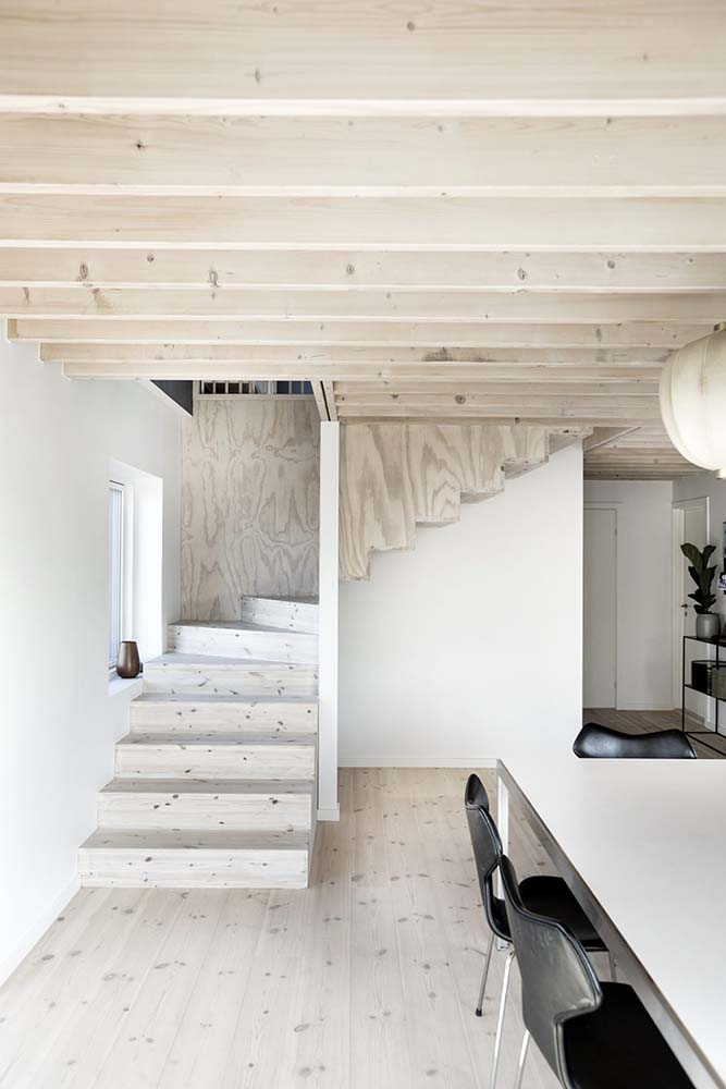 The staircase leads to the dining and kitchen area on the lower level.