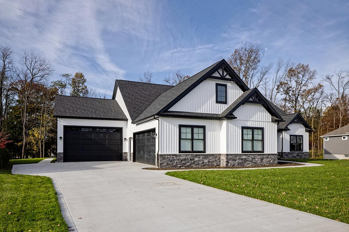 The oversized garage in an L-shape layout is attached to the left side of the home.
