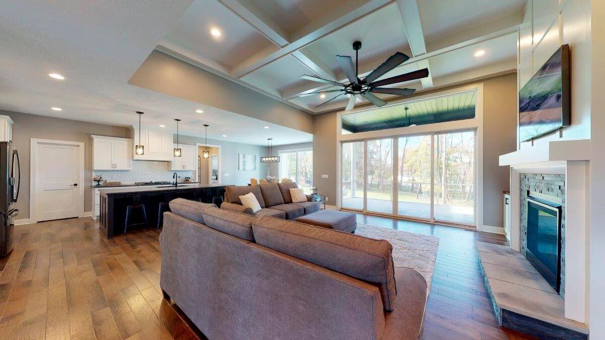 An open layout view showing the living room, kitchen, and dining area.