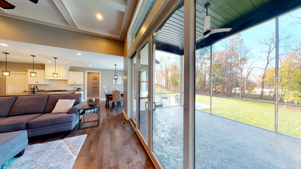 The glass doors across the living room open to the screened porch.