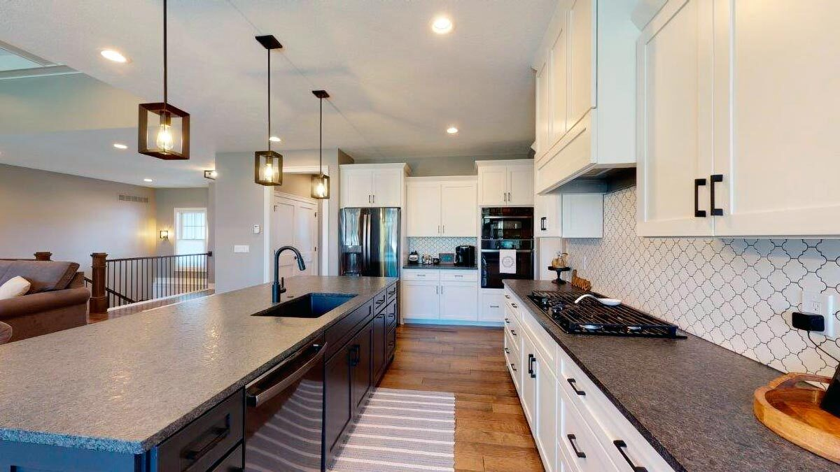 Black appliances and a walk-in pantry complete the kitchen.