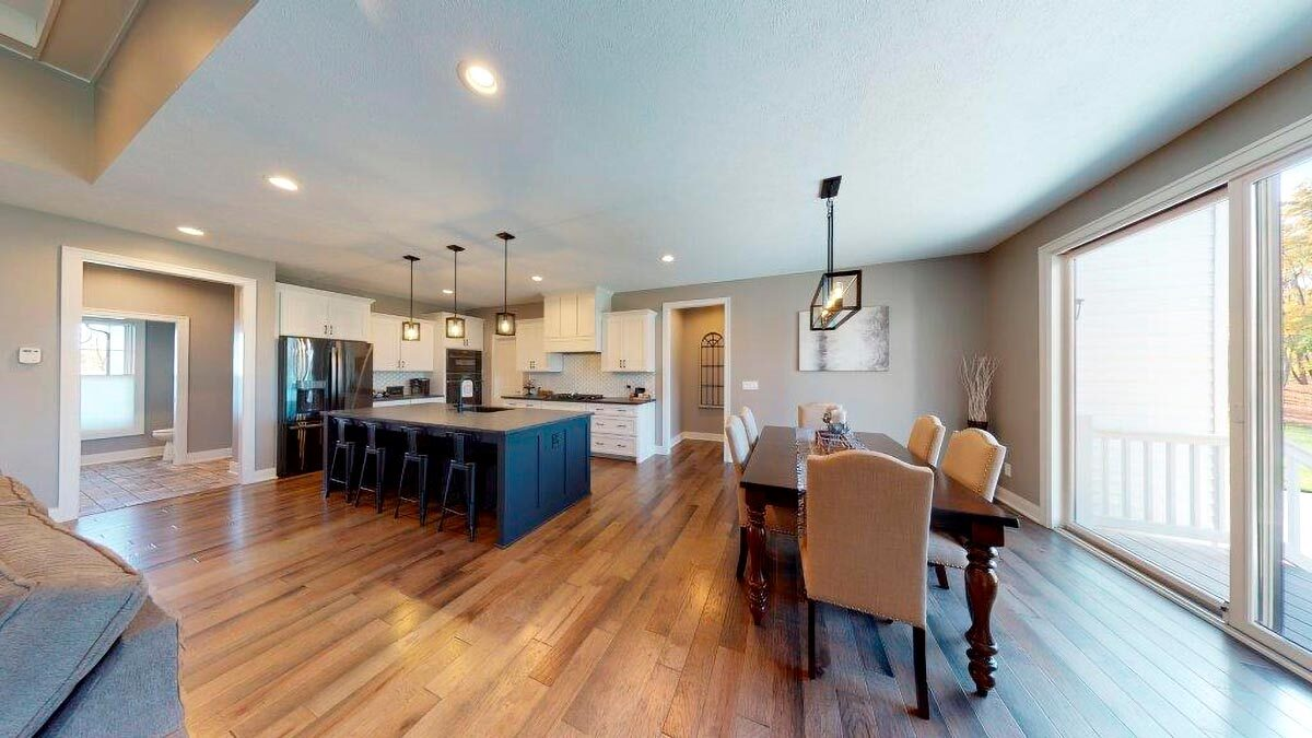 The dining room includes a large sliding door that opens to the outdoors.