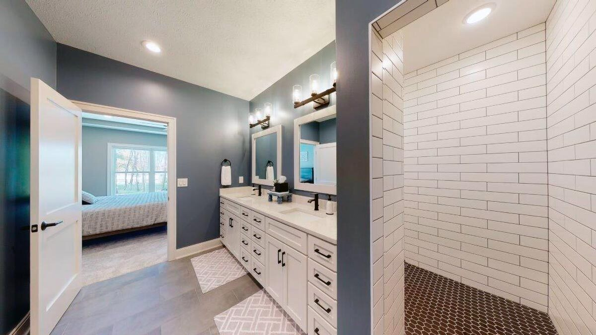 Primary bathroom with dual sink vanity and a walk-in shower.