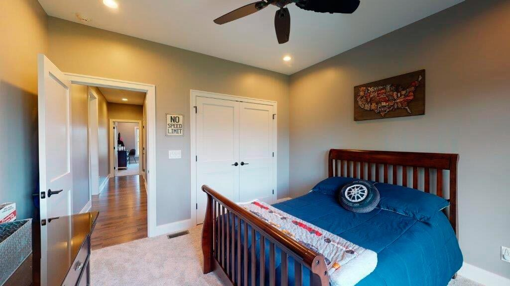 The bedroom includes a dresser and a built-in wardrobe.