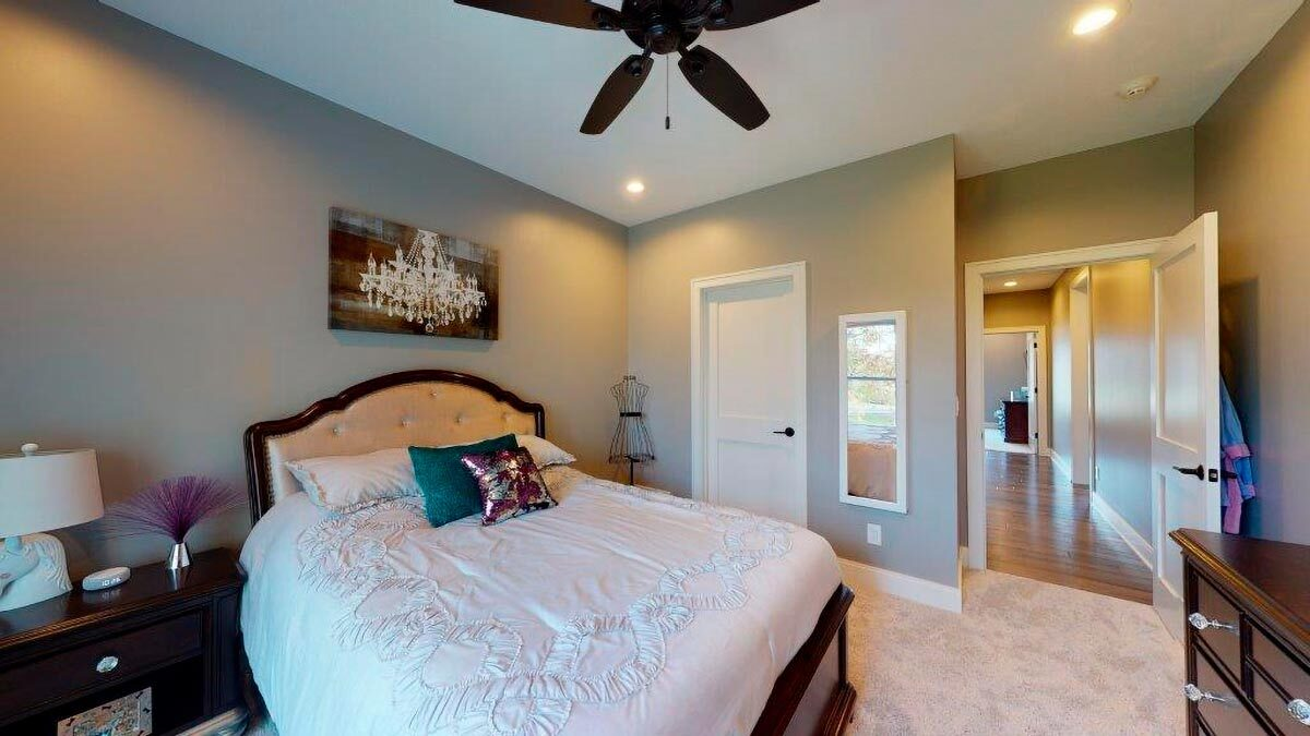 A walk-in closet concealed by the white door completes this bedroom.