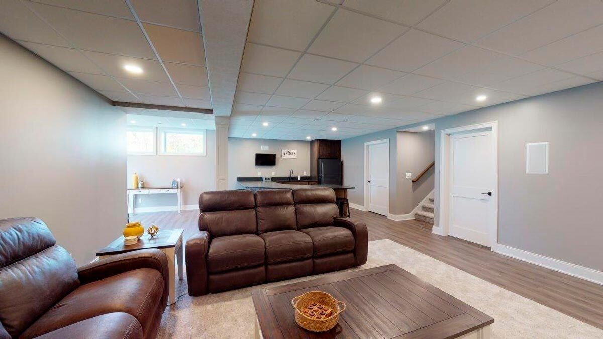 Behind the living space is a wet bar to complete the entertaining.