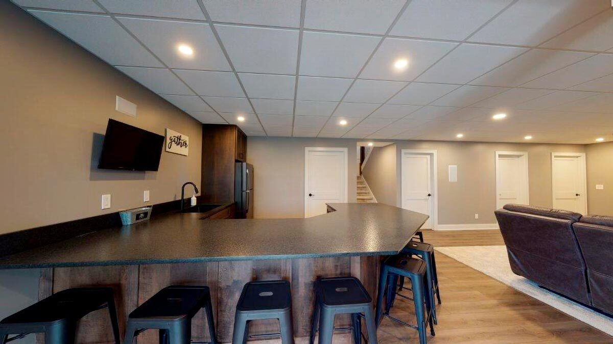 Another look at the wet bar showing the surrounding bar stools.