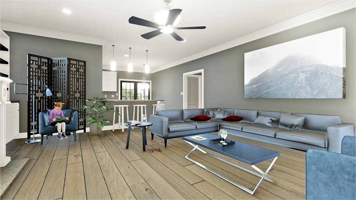 Living room with L-shaped sofa, wide plank flooring, and gray walls adorned with large artwork.