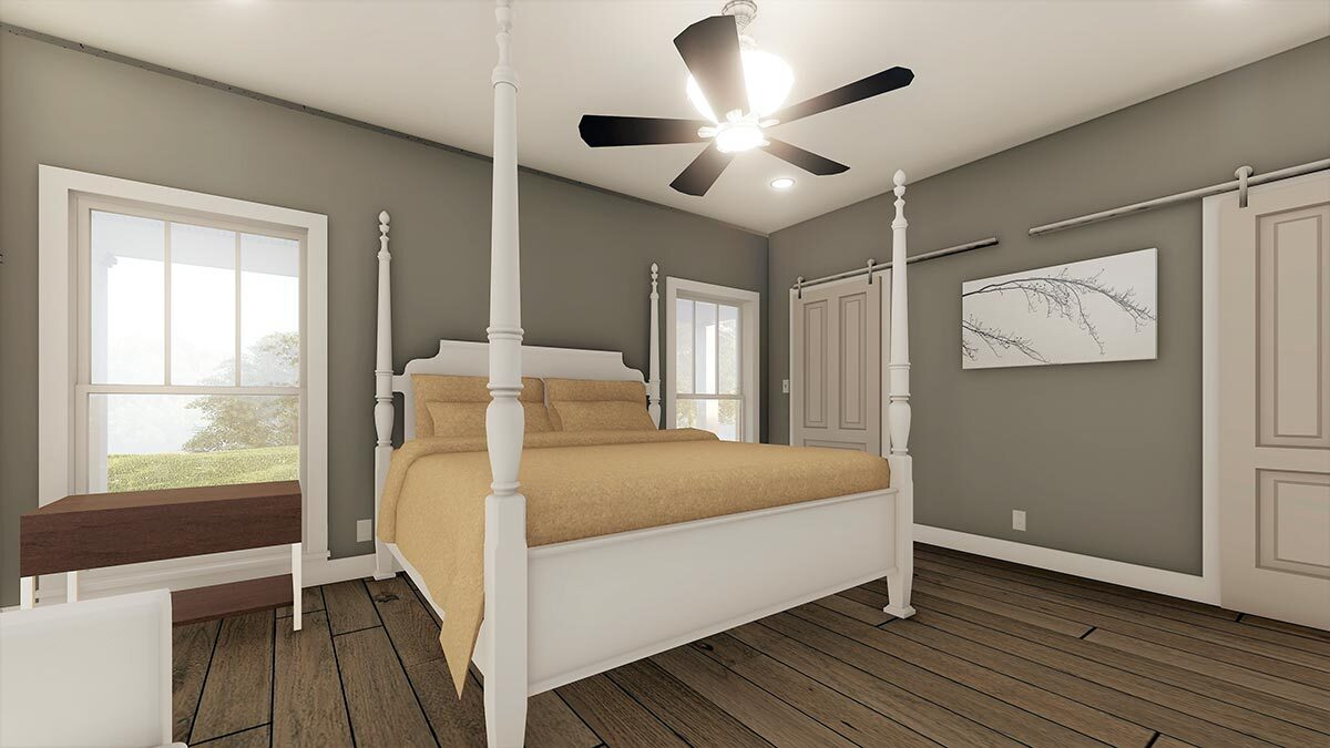 Primary bedroom with a four-poster bed and sliding barn doors that open to the primary bath and walk-in closet.