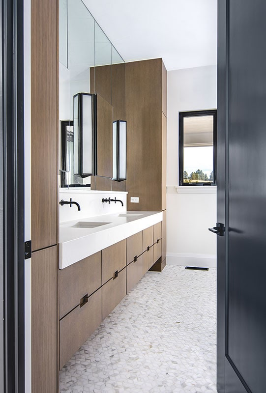 The primary bathroom features a dual sink vanity paired with a large paneled mirror.