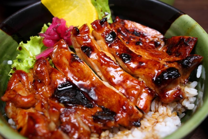 A rice bowl with chicken teriyaki topping.