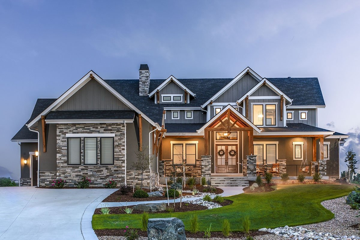 Night view of the craftsman home showcasing its ambient glow from the outdoor sconces.