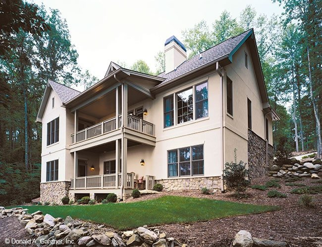Rear exterior view showing the stone accents and covered porches.