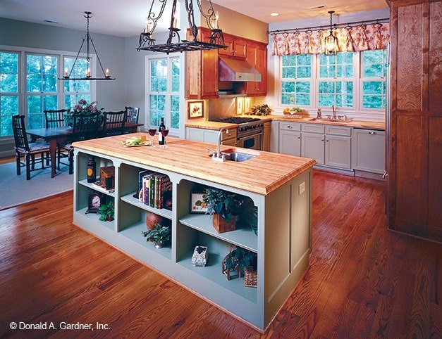 Across the kitchen is the dining area with a rectangular dining set.Across the kitchen is the dining area with a rectangular dining set.