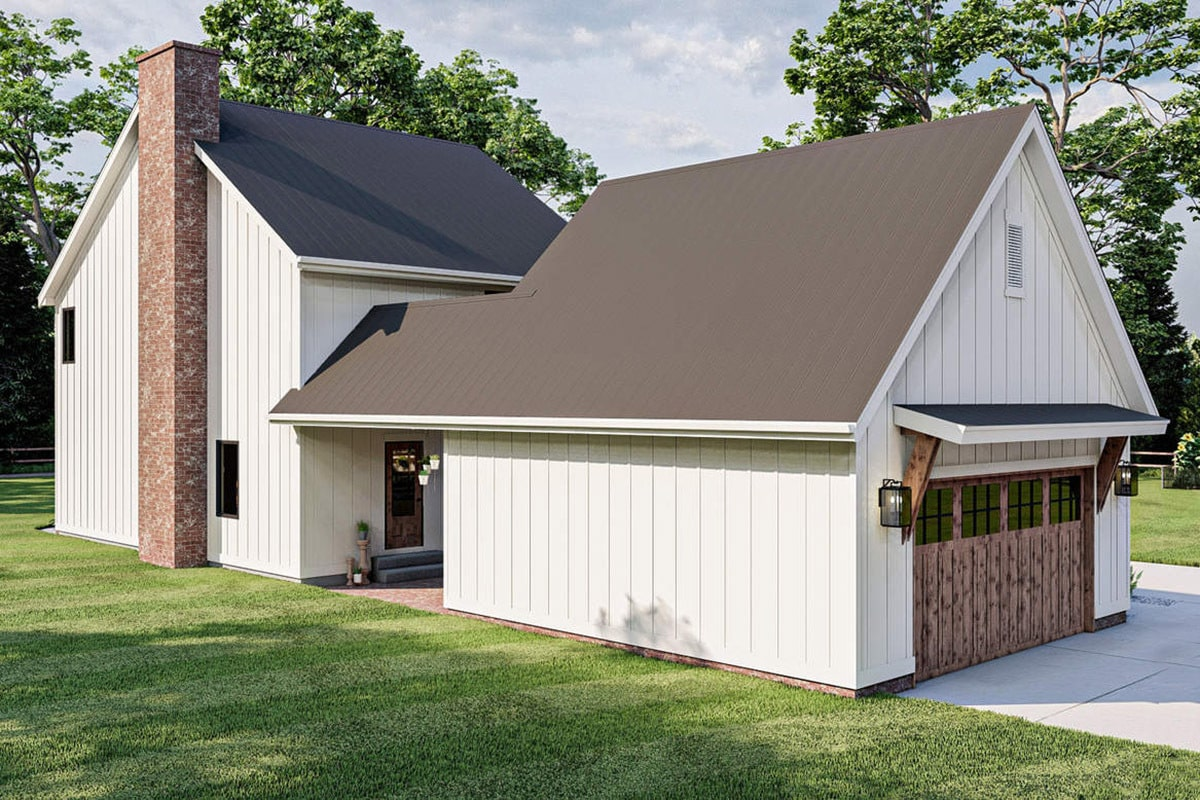 The garage is attached to the home's rear. It has the same siding plus a wooden garage door.