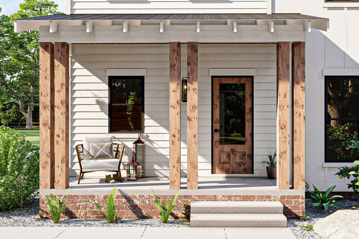 Entry porch with a cushioned seat, double columns, brick base, and a concrete stoop.