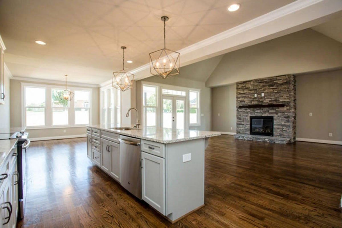 Across the kitchen is the living space with a large stone fireplace.