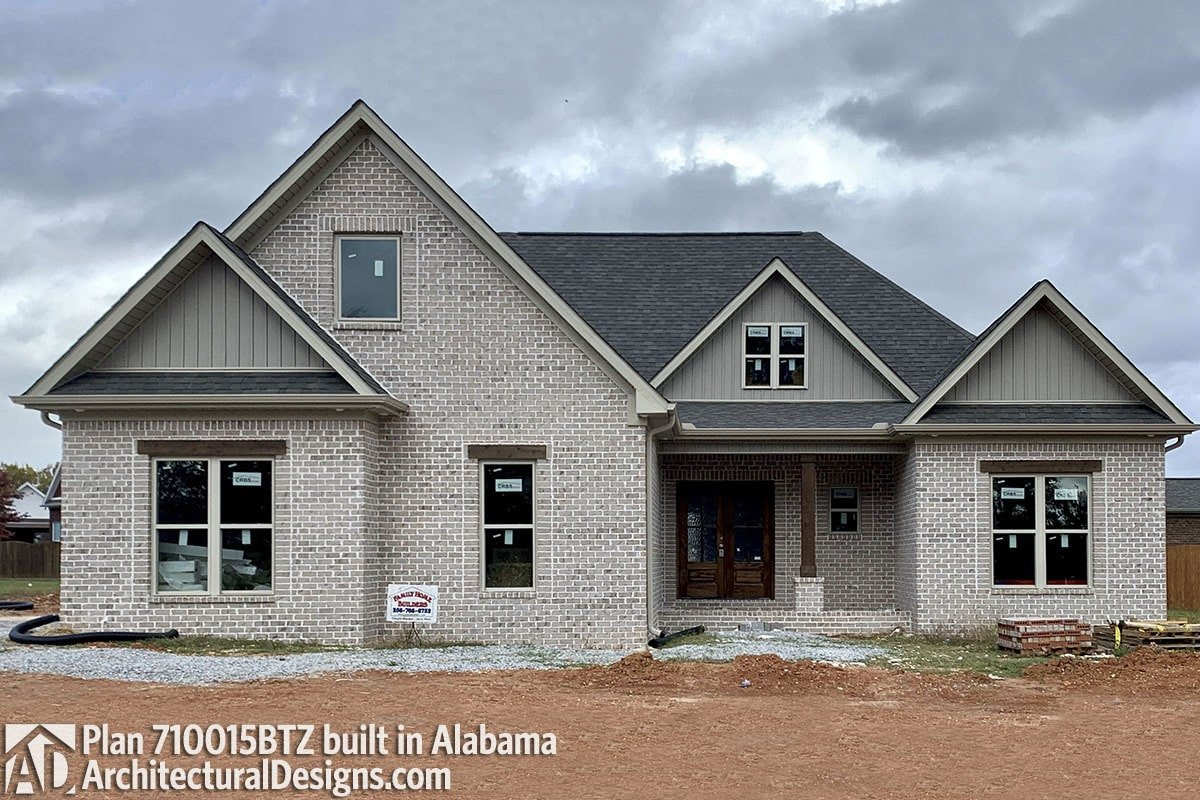 Alternate exterior with brick and siding, gable rooflines, and an entry porch lined with a rustic column.