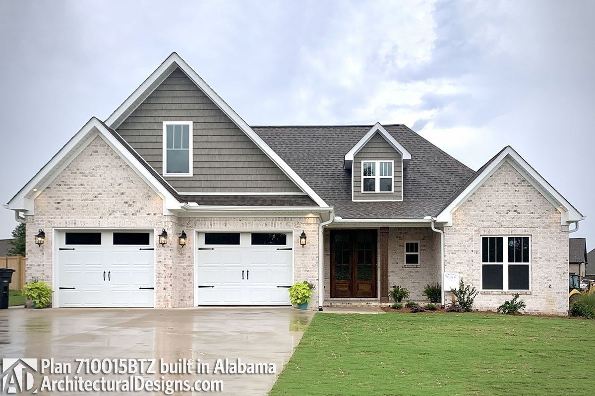 Another alternate exterior with cream brick siding, gable dormer, and a front entry garage.