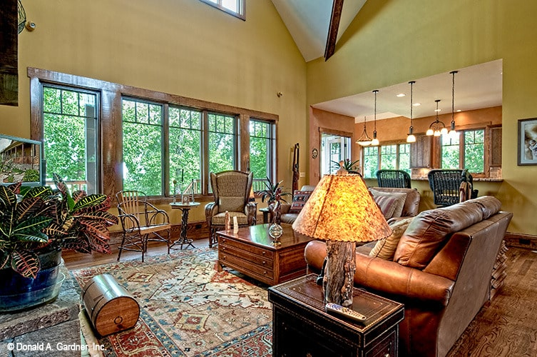 Living room with brown leather sofas, wooden coffee tables, and a vintage area rug.
