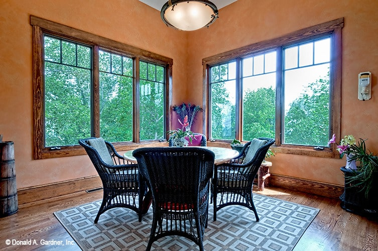 Breakfast room with a round dining set sitting on a patterned area rug.