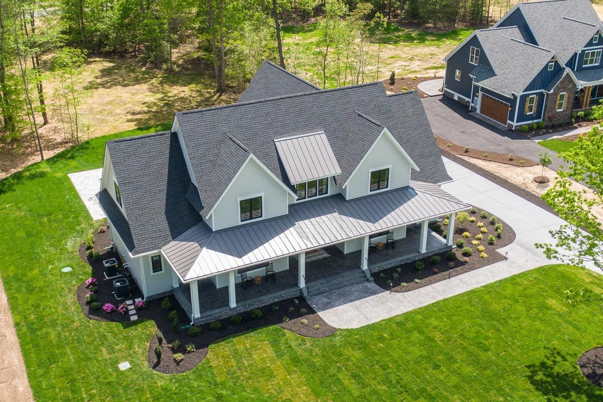 Aerial view of the house showing the gable rooflines and serene landscaping.Aerial view of the house showing the gable rooflines and serene landscaping.