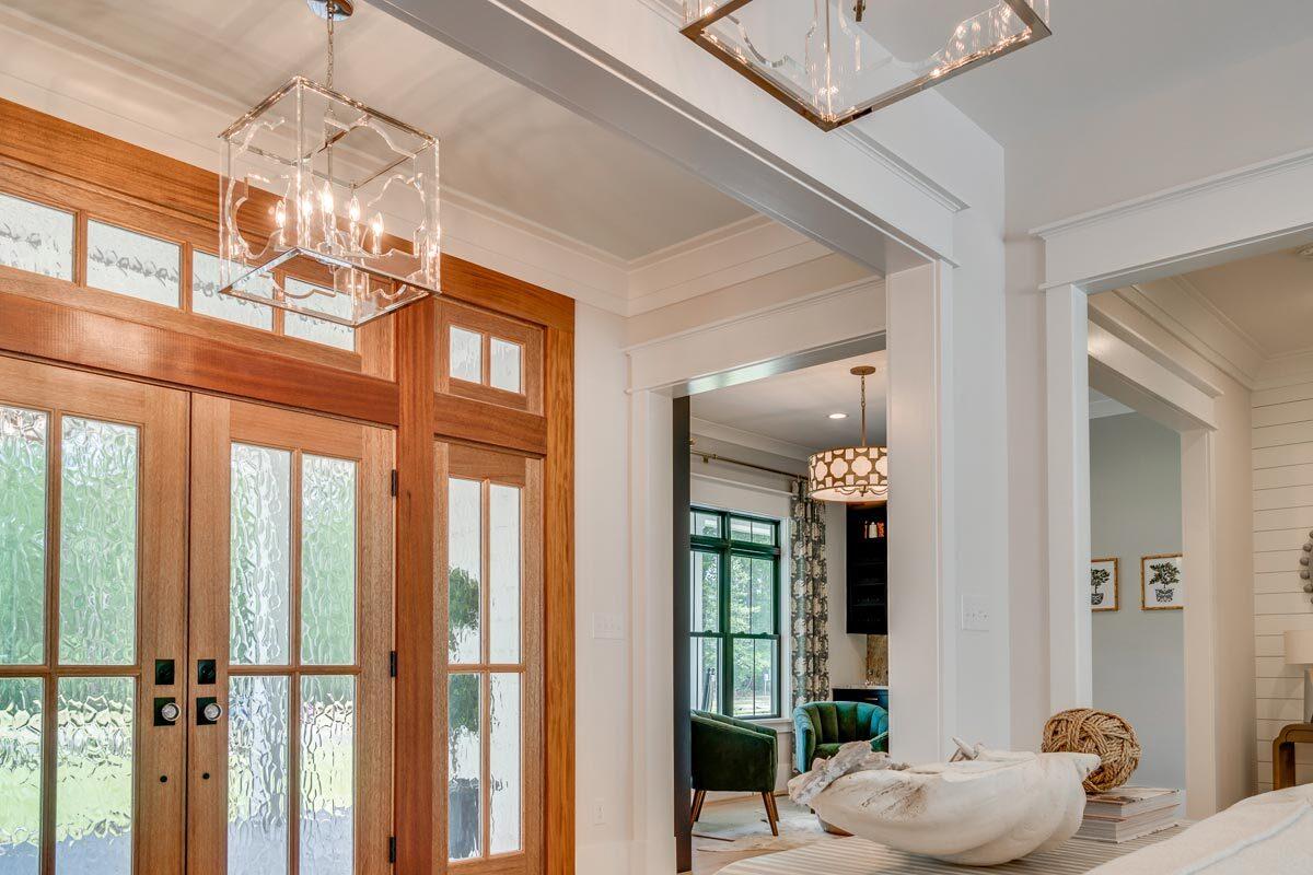 Inside, more glass pendants brighten the modern farmhouse.