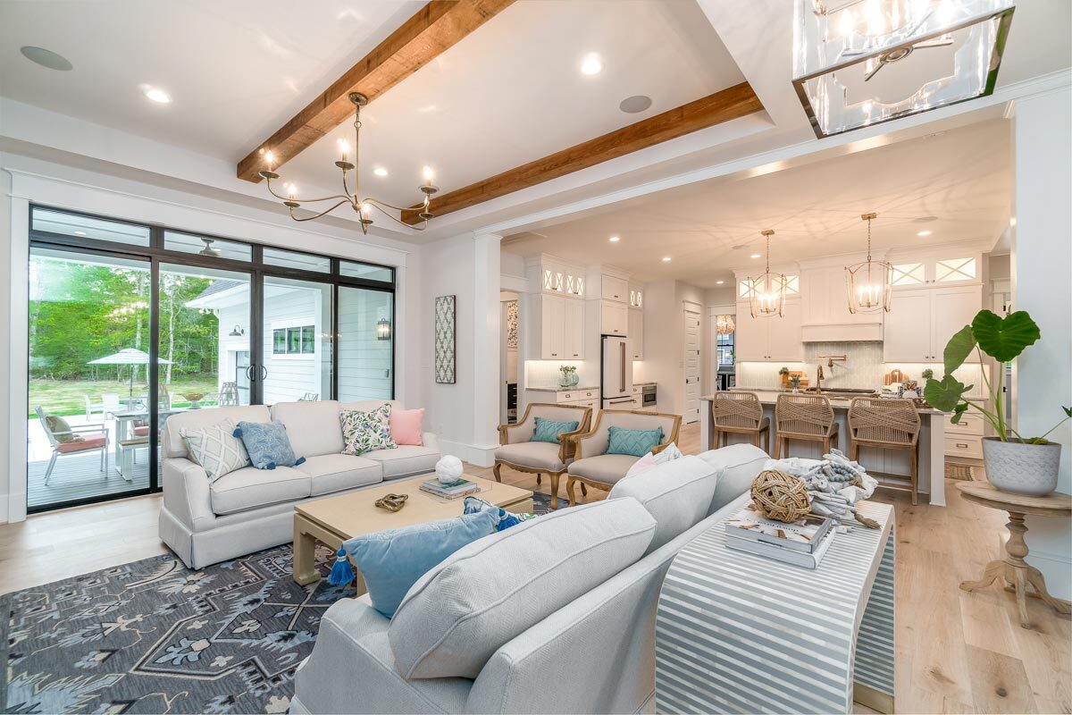 Glass doors at the back extend the living space onto a covered porch.