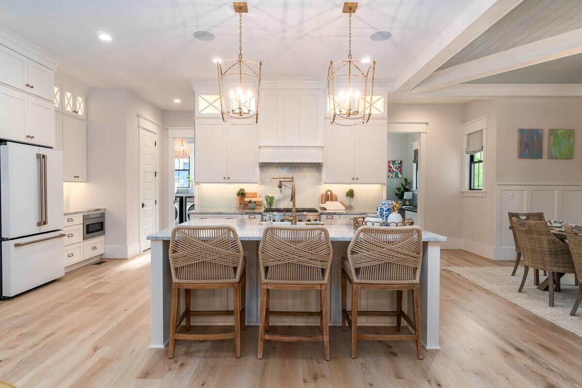 A couple of brass pendants emit a cozy ambiance to the kitchen.