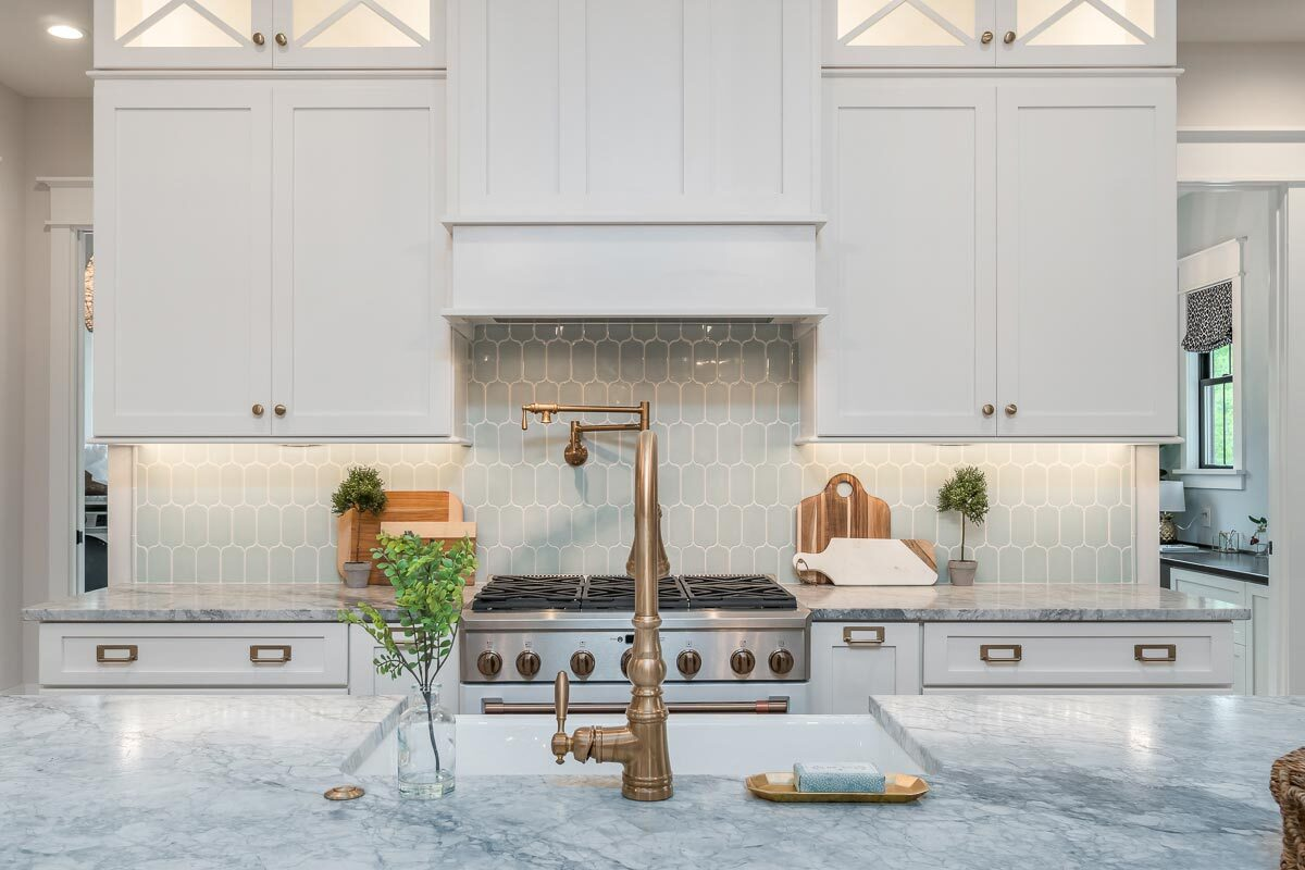 A closer look at the kitchen showing its lovely tiled backsplash.