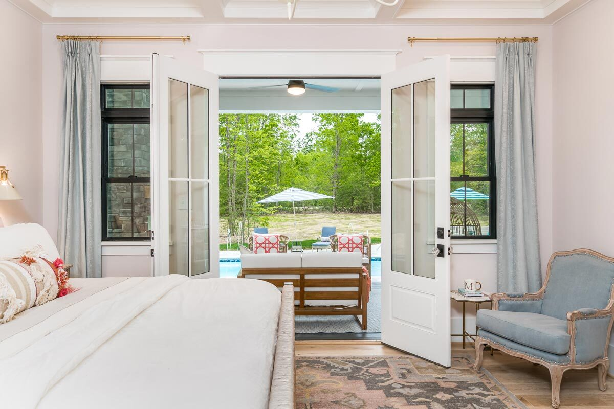 A closer look at the french door leading to the covered porch and onto the pool.