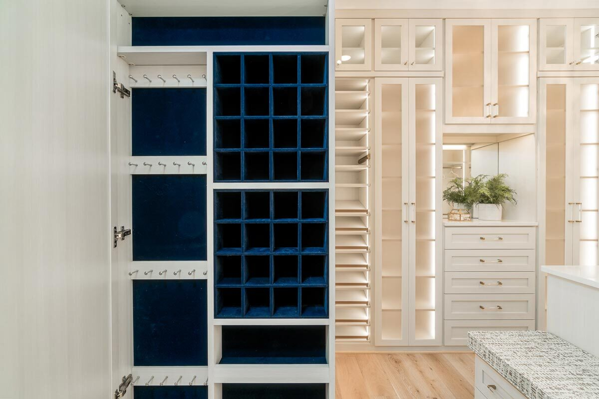 The walk-in closet includes a jewelry closet with blue velvet accents.