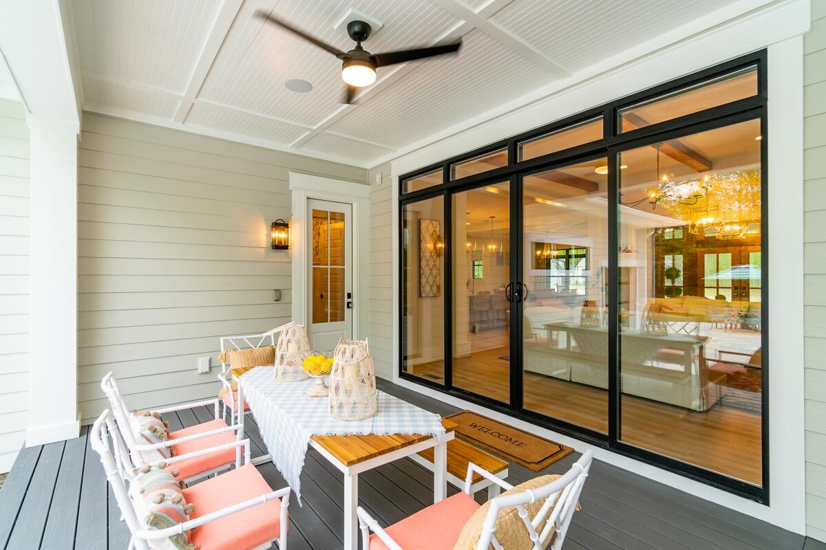 Off the living area is a covered porch with an outdoor dining.