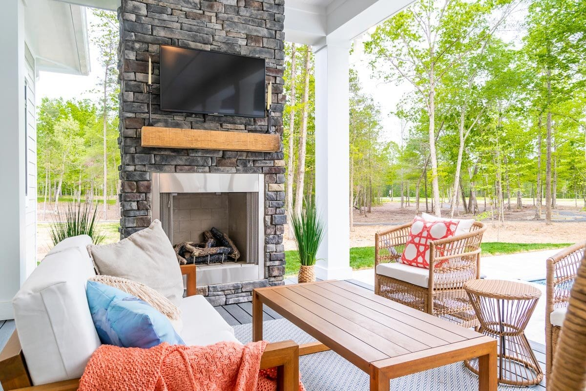 There's also an outdoor living filled with cozy seats and a fireplace topped with a TV.