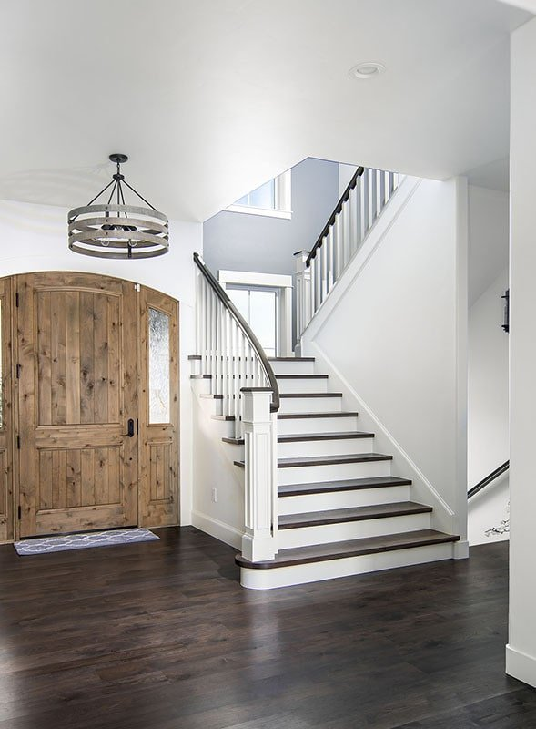 There's a staircase next to the entry door that leads to the bedrooms.