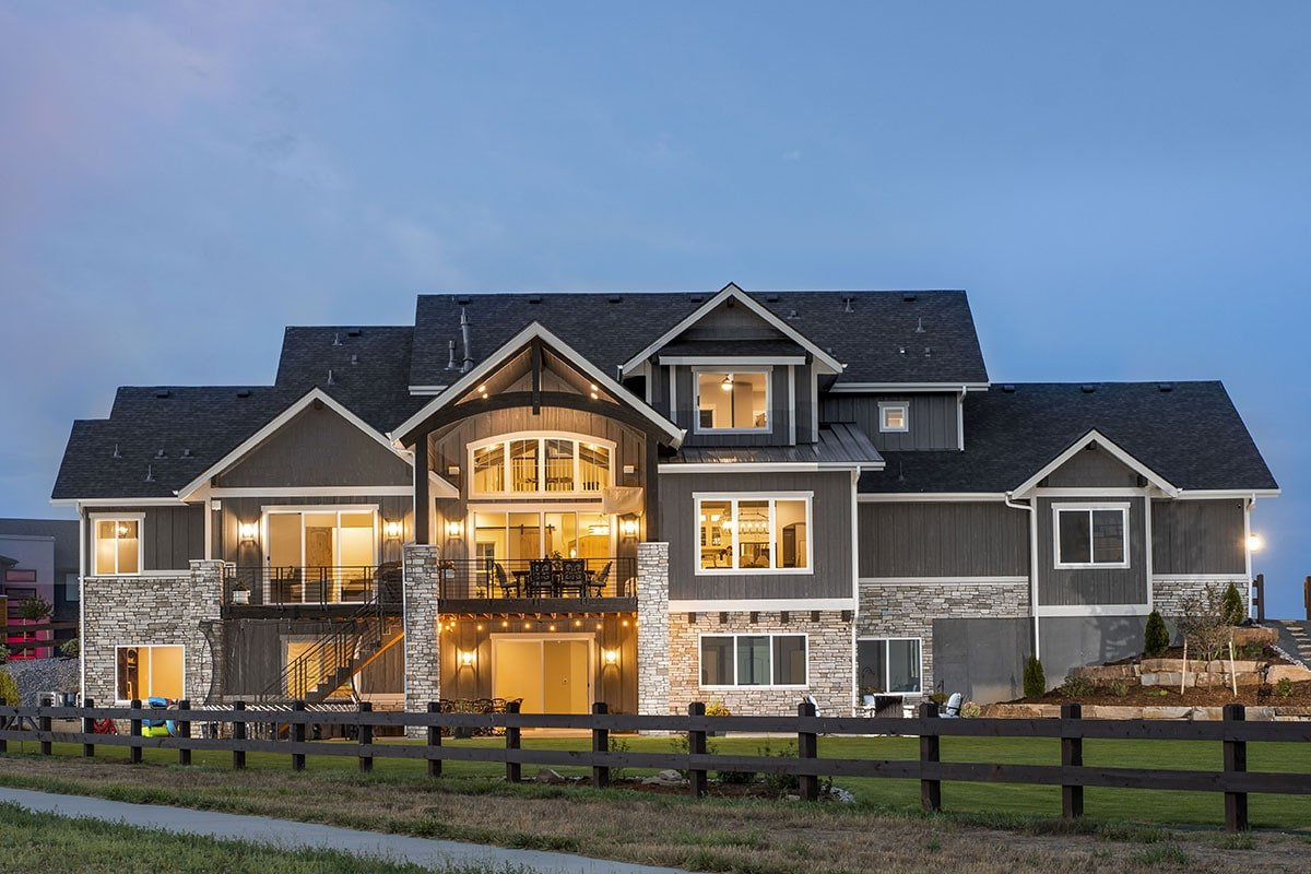 Night view of the home showing its ambient glow that complements the stone and siding.Night view of the home showing its ambient glow that complements the stone and siding.
