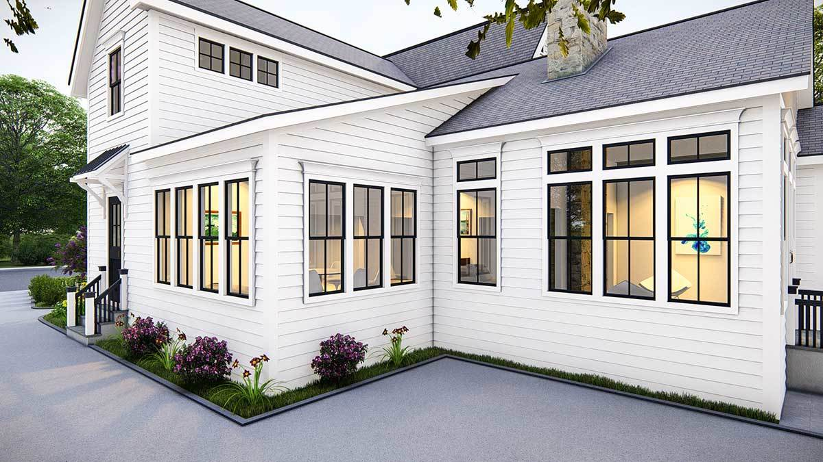 The home is embellished in white horizontal siding and tiled roofs.