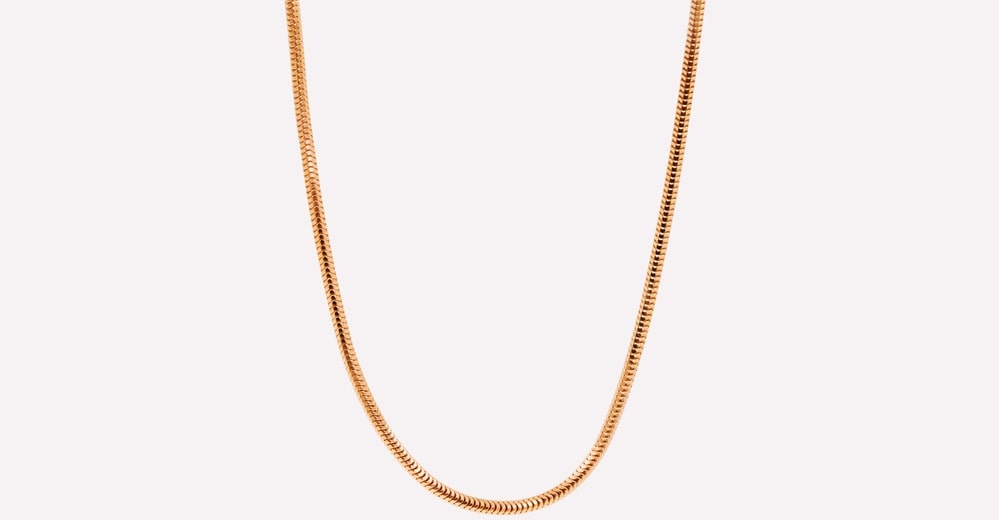 This is a close look at a golden snake chain.