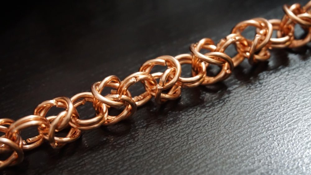 This is a close look at a necklace that has a Byzantine chain.