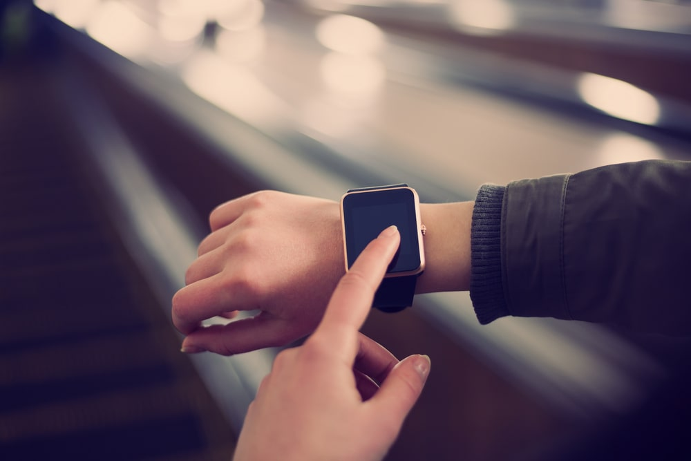 A woman wearing a smartwatch.