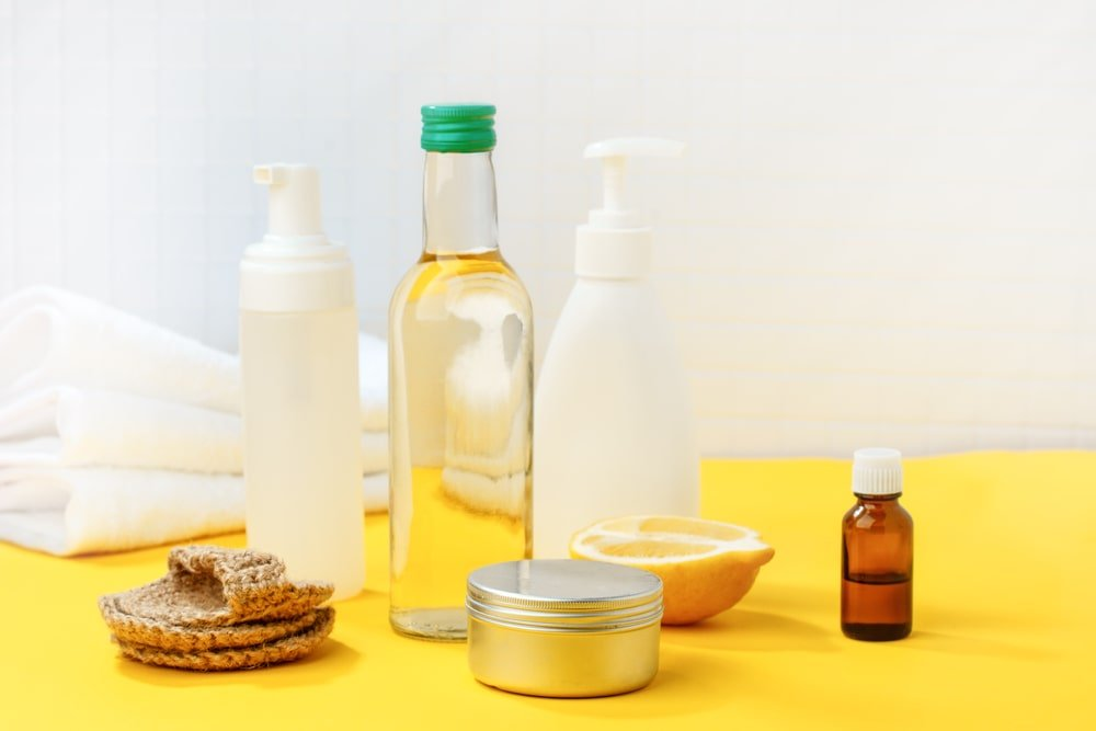 Eco-friendly natural cleaning products with vinegar and lemon.