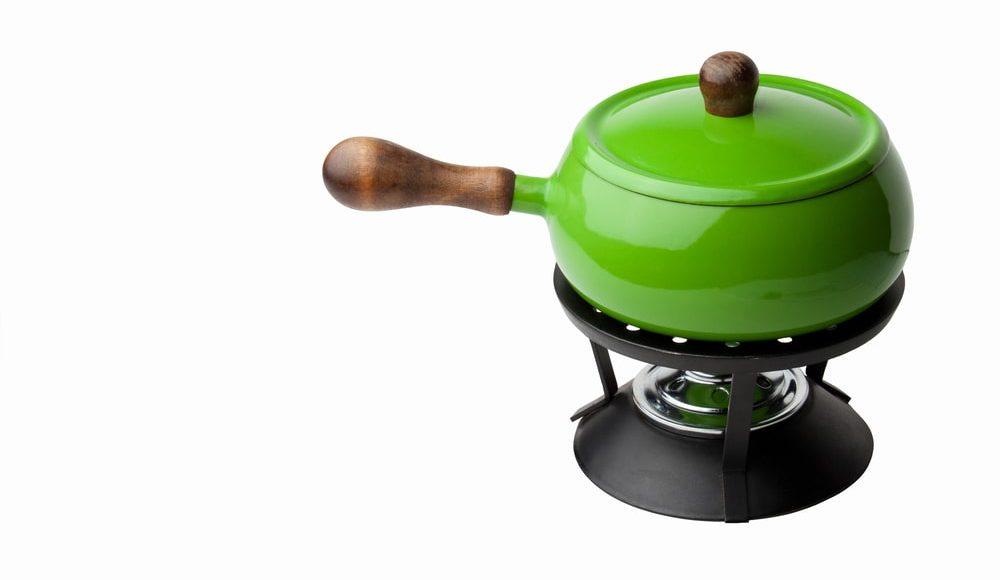 Green ceramic fondue pot