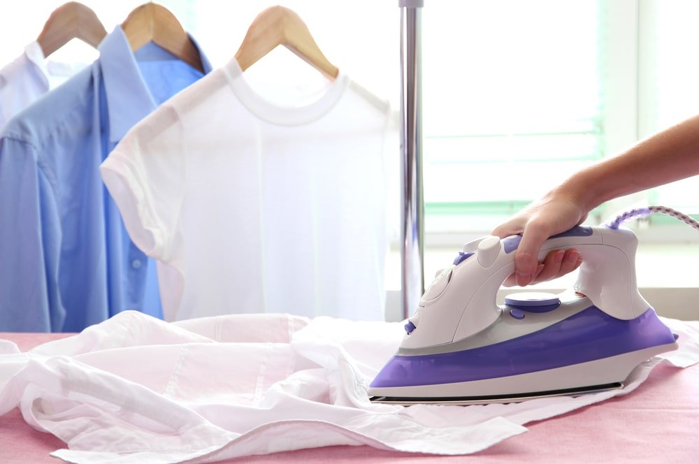 Woman ironing a shirt.