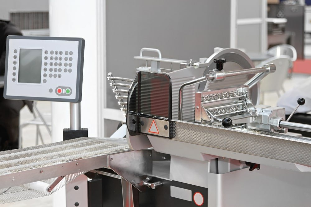 An automatic vertical meat slicer.