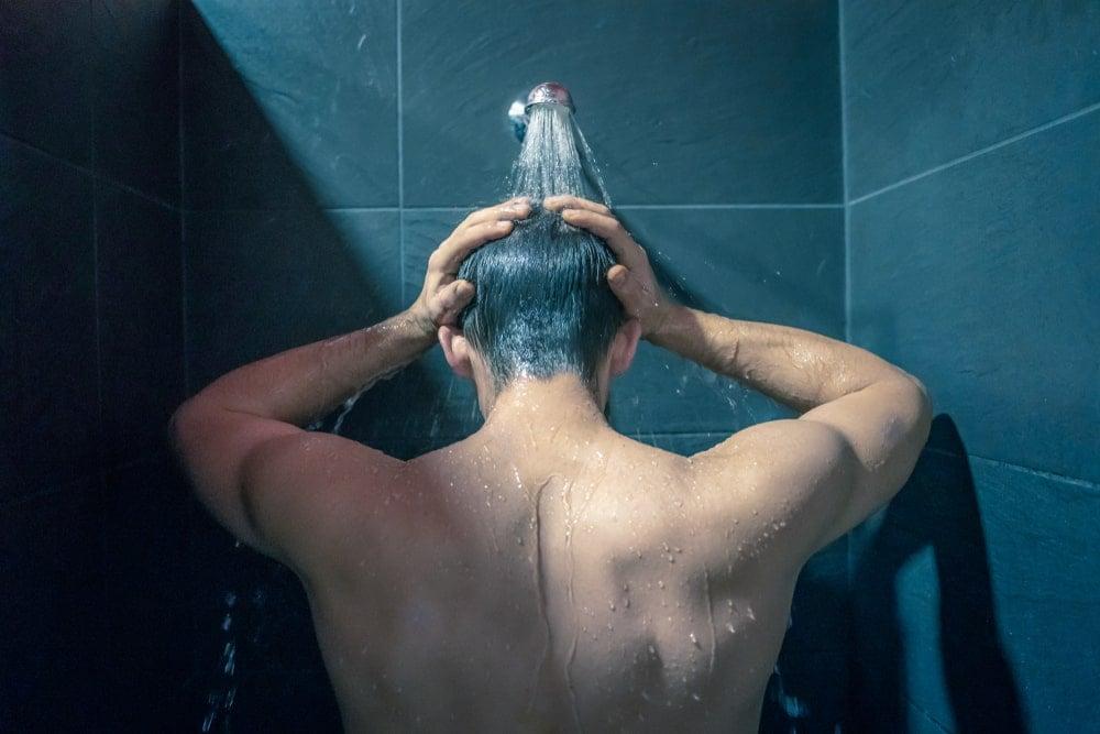 Man taking a shower.