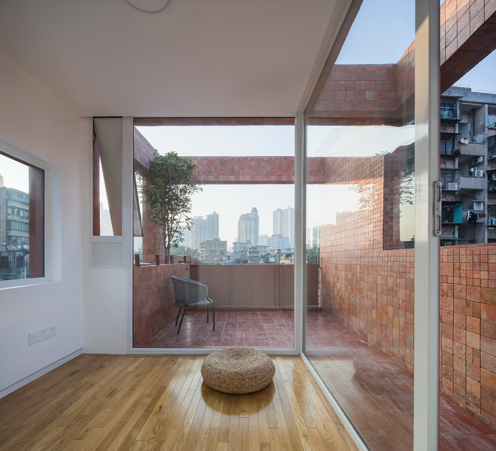 This is the bright area with glass walls separating the interior with the rooftop patio.