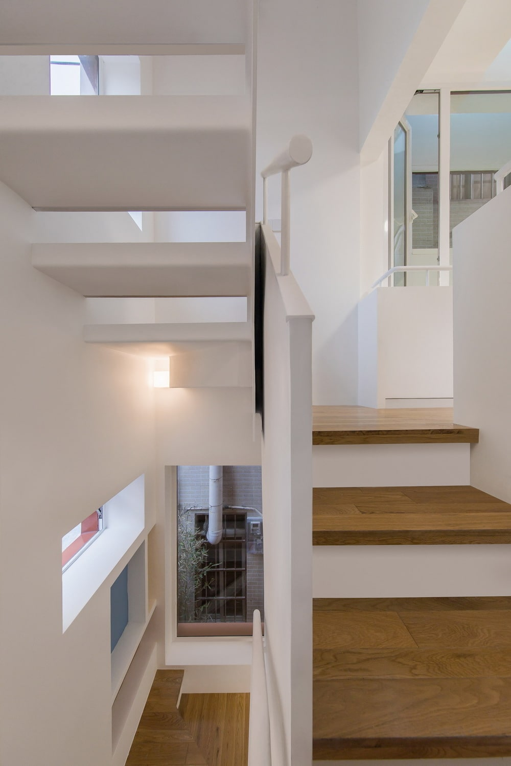 This is a close look at the staircase showcasing its wooden steps and a view of the foyer and landing.