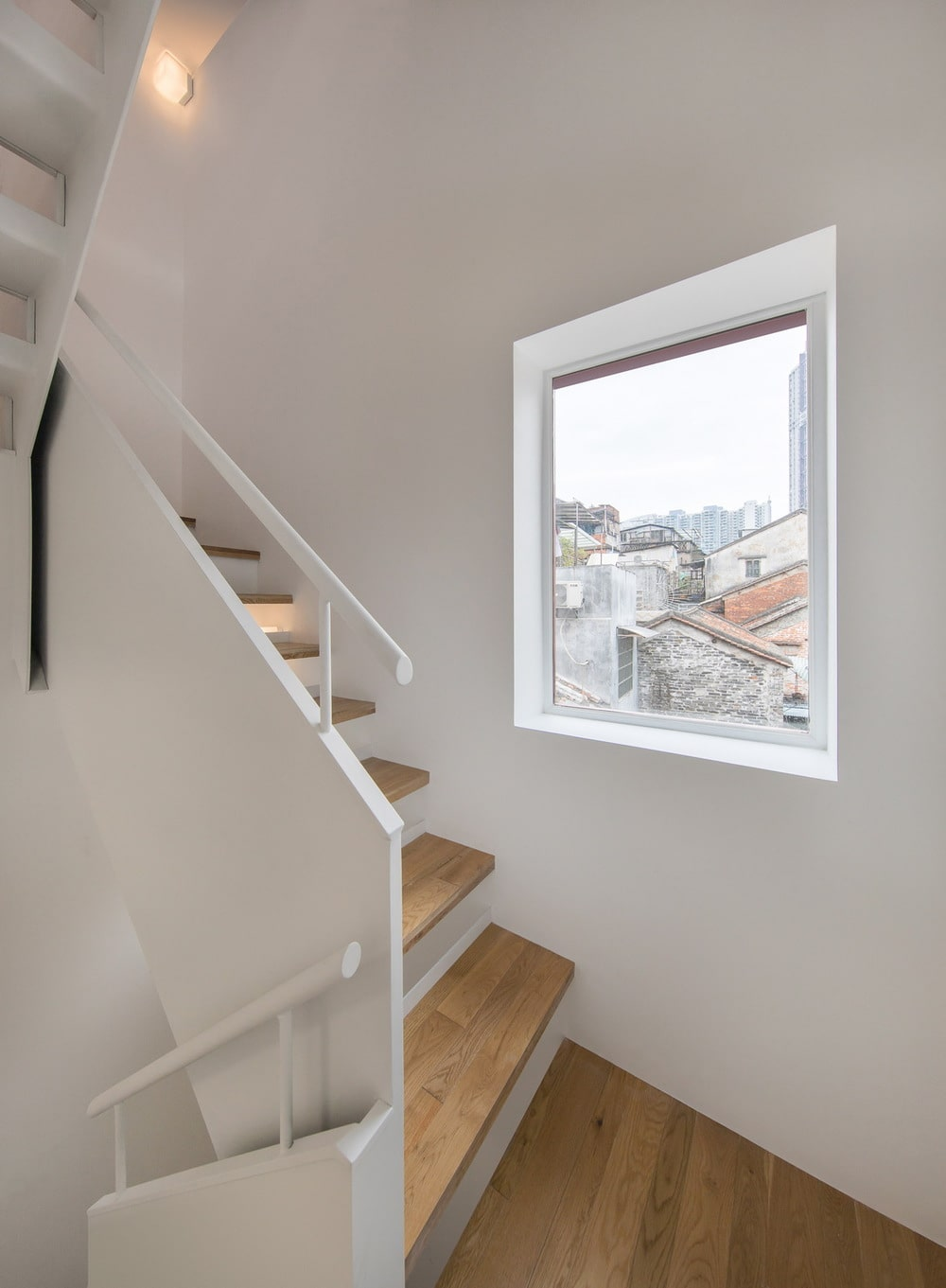 This is a look at the small window on the side of the staircase that brings in natural lighting.