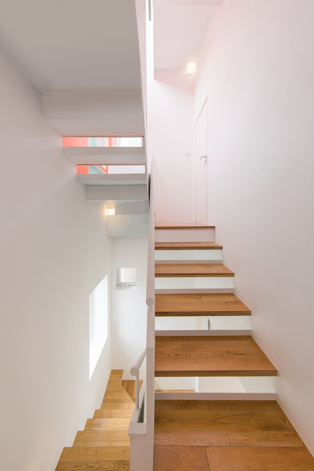 This is another look at the staircase that has bright white elements complemented by the wooden steps.