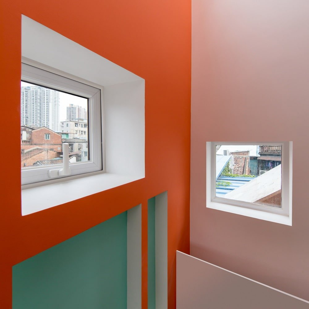 This is a closer look at the bright salmon tone of the walls complemented by the small windows.